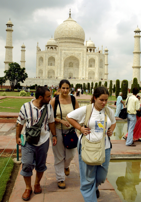 Foreign tourists visit the Taj Mahal in the tourist city of Agra.