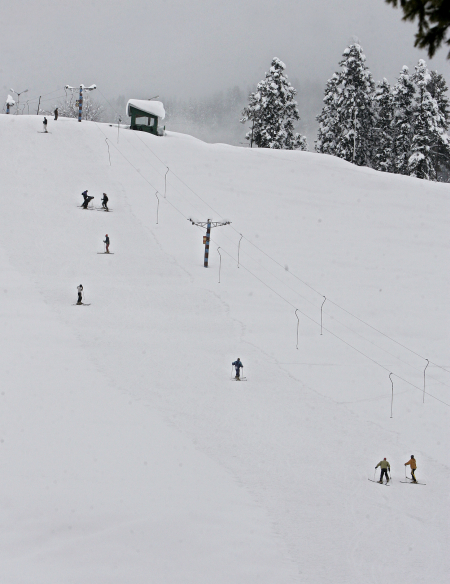 Skiers are seen on a slope after a snowfall in Gulmarg, west of Srinagar.