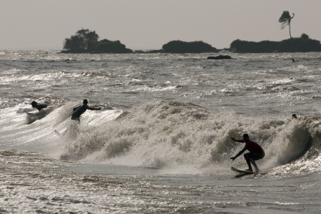 Surfers ride the waves in Marajo Bay near the mouth of the Amazon River.