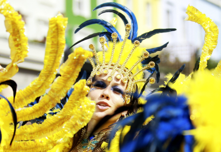A performer dances in the street parade at the annual Notting Hill Carnival in central London.