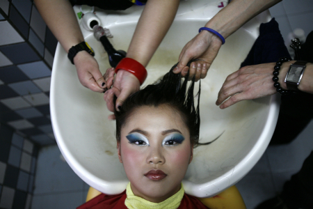 Students wash their classmate's hair in China Fukang Beauty and Hair School in Shanghai.
