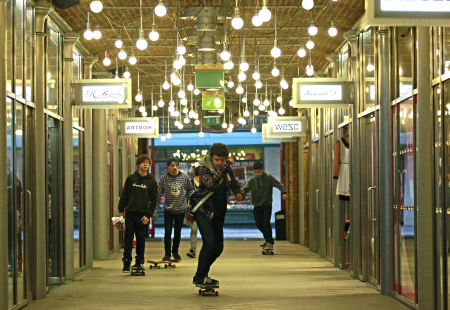 Youths skateboard through a shopping arcade at Covent Garden in London.