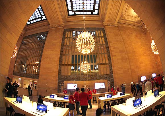 Apple laptops are seen on display inside the newest Apple Store in New York City's Grand Central Station.