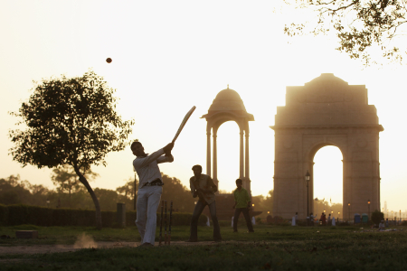 Children play cricket near the India Gate in New Delhi.