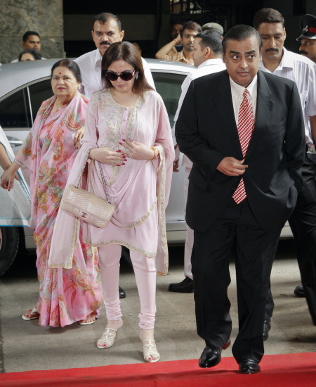 Mukesh Amban with his mother Kokilaben, left, and wife Nita, centre, in Mumbai.