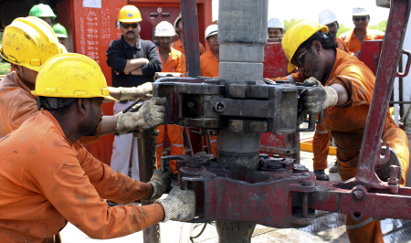 Engineers of Oil and Natural Gas Corp work inside the Kalol oil field in Gujarat.