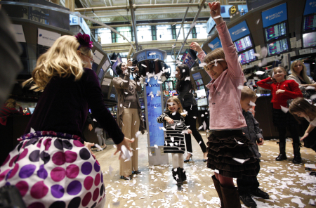 Children play on the floor of the New York Stock Exchange during the NYSE's annual kids' day.