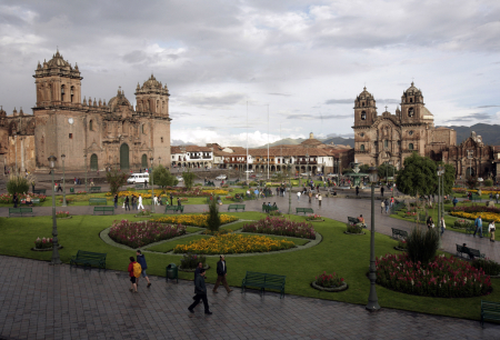 People walk in the main plaza in Cuzco, Peru.