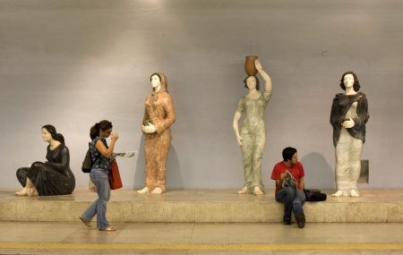 Passengers wait for their trains at a Lisbon's subway station. All subway stations in Lisbon have been decorated and designed by painters, sculptors, architects and designers from all over the world.