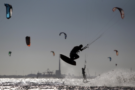 Kite surfers are seen at St Kilda beach in Melbourne.