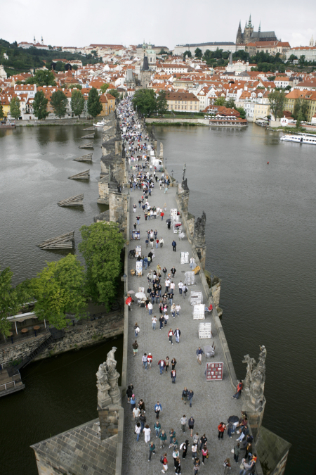 Tourists walk across the medieval Charles Bridge in Prague.