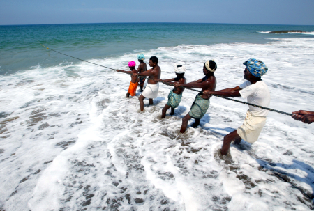 Fishermen pull in their catch in Kovalam Beach, about 20 km south of Trivandrum