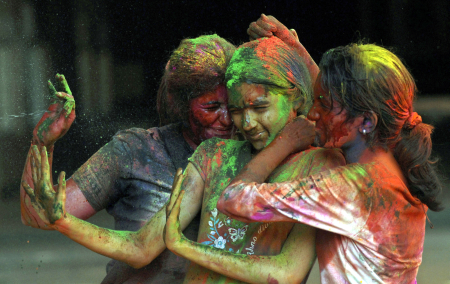 Girls celebrate Holi in Chennai.