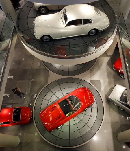 A man photographs cars on display at the Hellenic Motor museum in Athens.