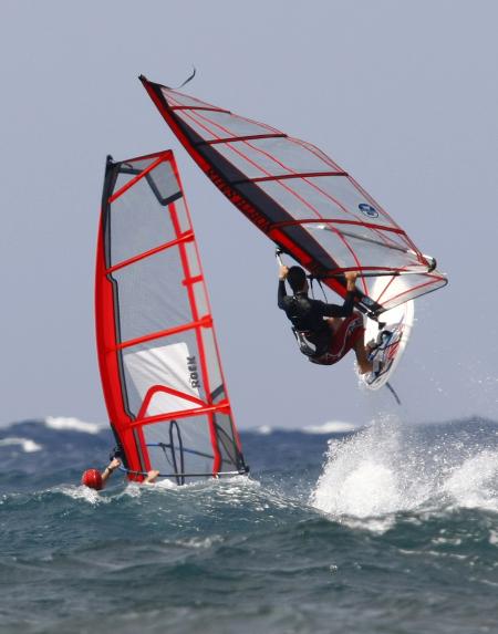 A man performs a jump while windsurfing off Bahar ic-Caghaq.
