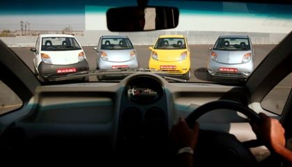Nano cars are displayed before a test drive session for journalists at the company's plant in Pimpri.