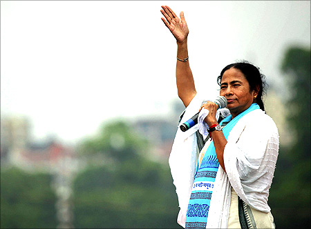West Bengal Chief Minister Mamata Banerjee addresses her supporters during a rally in Kolkata.