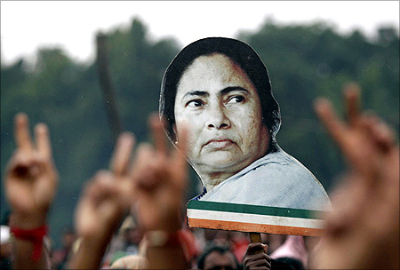 Supporters hold a cut-out of Mamata Banerjee.