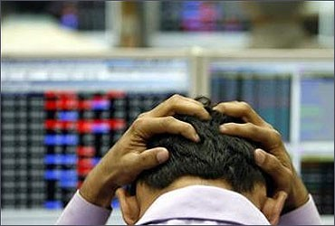 A stock broker reacts after a fall in the markets.
