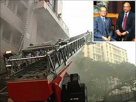 Firemen trying to rescue people trapped in the AMRI Hospital fire in Kolkata. (Inset) Emami Group founders R S Agarwal and R S Goenka.