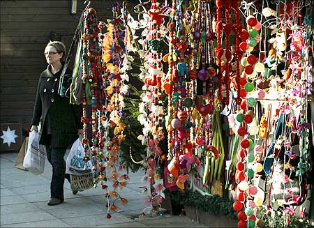 A pedestrian passes a shop selling Christmas goods in Brighton southern England.
