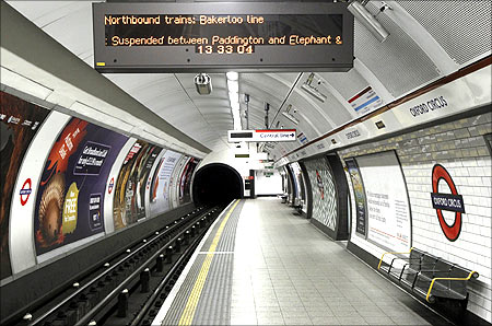 An illuminated sign hangs above an empty Bakerloo line platform at Oxford Circus station, in central London.