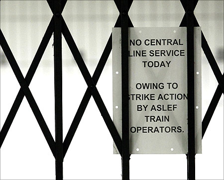 A service status notice is attached to gates at Oxford Circus station, in central London,