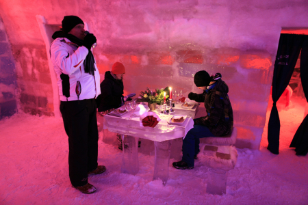 Tourists have dinner inside the Balea Lac Hotel of Ice in the Fagaras mountains.