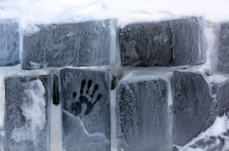 A hand print is seen on the outside wall of the Balea Lac Hotel of Ice in the Fagaras mountains.