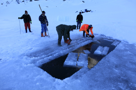 Workers cut ice bricks for the Balea Lac Hotel of Ice in the Fagaras mountains.