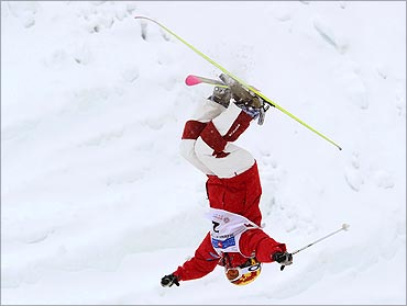 Jennifer Heil, Canada does a backflip during Freestyle Ski Mogul's World Cup Ladies' competition.