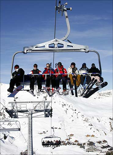 Skiers on a chairlift are at Les Crosets, east of Geneva.