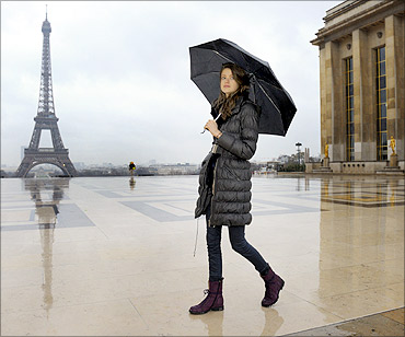 Swiss model Julia Saner walks near the Eiffel tower.