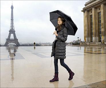 Swiss model Julia Saner walks near the Eiffel tower.
