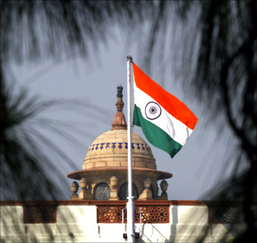 An Indian national flag flutters on top of the Parliament building in New Delhi.