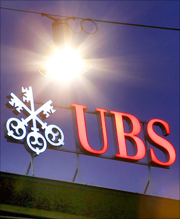 The logo of Swiss Bank UBS is pictured on the roof of the company's headquarters in Zurich.