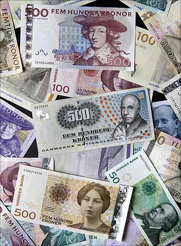Swedish kronor, Norwegian kronor, and Danish kronor notes in various denominations are seen.