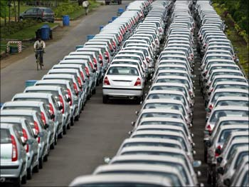 Cars lined up at a car manufacturing unit.