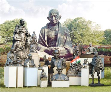 A collection of Gandhi statues. Also seen in the picture is Ram Sutar.