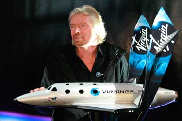 Richard Branson with model of SpaceShipTwo.