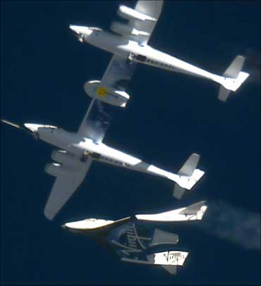 The Virgin Galactic SpaceShip2 (VSS Enterprise) (bottom) is released at 46,000 feet (14,020 meters) from the WhiteKnight2 (VMS Eve) mothership (top), over Mojave, California October 10, 2010.