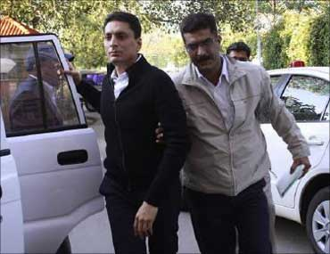 Shahid Balwa (L) being led away by the CBI.