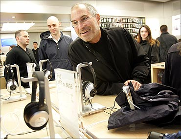 Steve Jobs smiles at the grand opening of the new Apple Store on 5th Avenue in New York, May 2006.