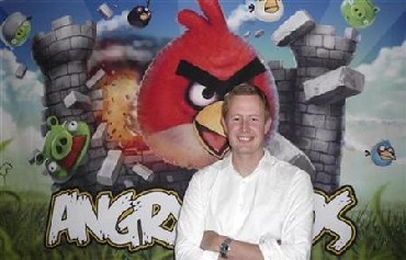 Mikael Hed, chief executive of Rovio, known for its Angry Birds game, stands in front of an Angry Birds.