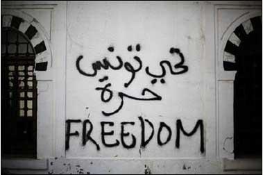 Revolutionary graffiti adorns a wall in Tunis.
