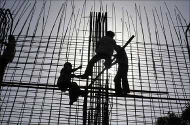 Labourers work at a riverfront construction site near the Sabarmati river in Ahmedabad.