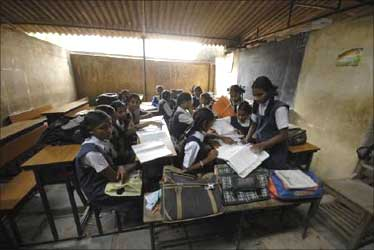 Schoolgirls study in a classroom of a government-run school in Hyderabad.