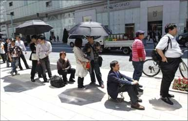 Apple fans standing in queue to buy the iPad in Tokyo.