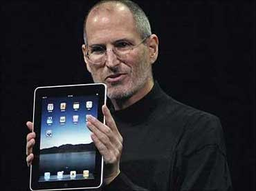 Steve Jobs with an iPad.
