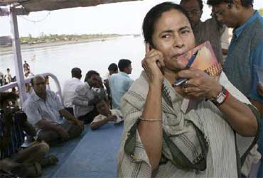 Railway Minister Mamata Banerjee speaks on a mobile phone.